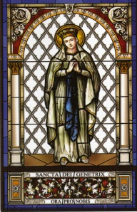 stained glass window featuring our Lady of Lourdes